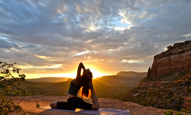 Doing Yoga overlooking Sedona